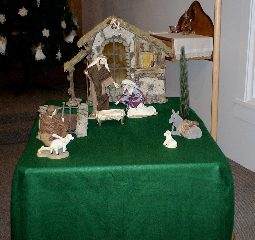 Right: The nativity scene finally ready with everyone there for the Birth of Jesus.