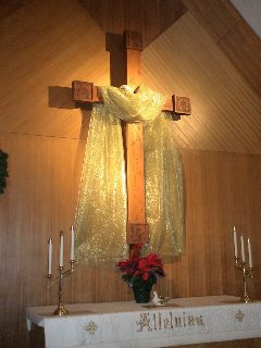 Left: Our large cross, decorated with gold cloth to symbolize the magnificence of the birth of Jesus.