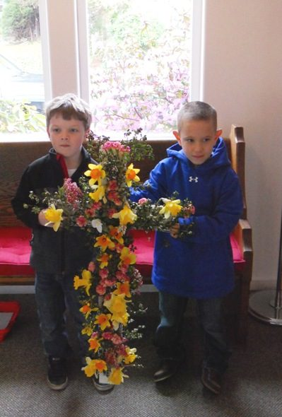 Aaron & Jeffrey carry in the flower cross in the procession!