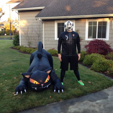 A new blowup decoration for the church for Halloween--a scary black cat!  The other soccer head guy is one of our teenagers!!